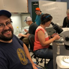 Nicole from Smith Lab (UF) dissects insect gut fungi and Dr. Alejo Rojas (Duke) provides comedic relief